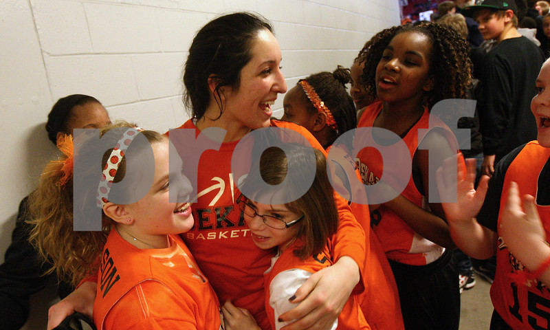 Kyle Bursaw — kbursaw@shawmedia.com<br /> <br /> DeKalb's Rachel Torres is hugged by fans in a hallway of the Convocation Center following the Barbs 36-18 victory over Sycamore in their annual game at the Convocation Center in DeKalb, Ill. on Friday, Jan. 25, 2013.