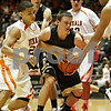 Rob Winner – rwinner@shawmedia.com<br /> <br /> Sycamore's Devin Mottet (center) is pressured by DeKalb's Rudy Lopez (left) and Andre Harris during the second quarter at the Convocation Center in DeKalb, Ill., Friday, Jan. 25, 2013.