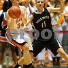 Kyle Bursaw — kbursaw@shawmedia.com<br /> <br /> DeKalb's Rachel Torres makes a pass in front of Sycamore's Paige Wogen in the second half. DeKalb defeated Sycamore 36-18 in their annual game at the Convocation Center in DeKalb, Ill. on Friday, Jan. 25, 2013.