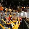 Rob Winner – rwinner@shawmedia.com<br /> <br /> Freshman David Long, 14, hands out balloons to DeKalb fans during the third quarter of the girls game between Sycamore and DeKalb at the Convocation Center in DeKalb, Ill., Friday, Jan. 25, 2013.