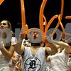 Rob Winner – rwinner@shawmedia.com<br /> <br /> Junior Ethan Graves (center) cheers on the DeKalb girls basketball team during the third quarter at the Convocation Center in DeKalb, Ill., Friday, Jan. 25, 2013.
