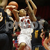 Rob Winner – rwinner@shawmedia.com<br /> <br /> Northern Illinois' Satavia Taylor (14) is fouled from behind while attempting a shot by Toledo's Naama Shafir during the first half in DeKalb, Ill., Saturday, Jan. 26, 2013. Toledo defeated NIU, 44-42.