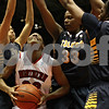 Rob Winner – rwinner@shawmedia.com<br /> <br /> Northern Illinois' Shaakira Haywood (33) looks to take a shot as a trio of Toledo defenders provide pressure during the first half in DeKalb, Ill., Saturday, Jan. 26, 2013. Toledo defeated NIU, 44-42.