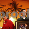 Kyle Bursaw – kbursaw@shawmedia.com<br /> <br /> Mark Pietrowski Jr, chair of the DeKalb County Democrats brings around a framed photo of Obama taken by local member Cliff Cleland being raffled off at their celebration at Cabana Charley's Tiki Bar & Grill in Sycamore, Ill. on Monday, Jan. 21, 2013.