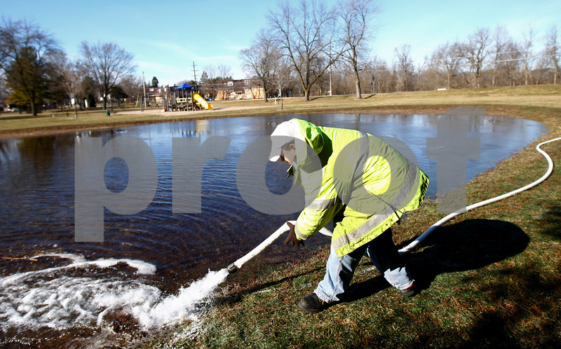 Kyle Bursaw – kbursaw@shawmedia.com<br /> <br /> DeKalb Park District employee Jesse Hernandez moves a hose while filling up the area for the outdoor skating rink at Lions Park in DeKalb, Ill. on Tuesday, Jan. 22, 2013. Hernandez said they started the project early Tuesday morning and filling the rink would likely continue tomorrow morning.