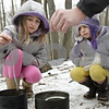 Rob Winner – rwinner@shawmedia.com<br /> <br /> Sisters Kaylee (left), 8, and Jenna, 4, of DeKalb, patiently make candles using a piece of string different colored waxes with their father Tim Luetkebuenger during WinterFest at the Russell Woods Forest Preserve in Genoa, Ill., Saturday, Jan. 19, 2013.
