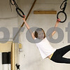 Kyle Bursaw – kbursaw@shawmedia.com<br /> <br /> Janae Heegaard, 9, swings across the rings hanging at Moose (L)-Up in Sycamore, Ill. on Friday, Jan. 11, 2013. Doctors found a Wilms' tumor in Janae's kidney when she was five years old. As a result of the chemotherapy, one of Janae's kidneys was removed and she also developed neuropathy, which led to some stunted growth in her legs and Achilles tendon. Her parents were told that Janae would recover about 90 to 95% but would probably not be able to play on a competitive level in sports that required heavy use of the legs.