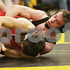 Rob Winner – rwinner@shawmedia.com<br /> <br /> Sycamore's Austin Culton (right) controls Ottawa's Kyle Damyen in a 152-pound match during the Northern Illinois Big 12 Conference Tournament in Sycamore, Ill., Saturday, Jan. 19, 2013. Culton won with a pin over Damyen.