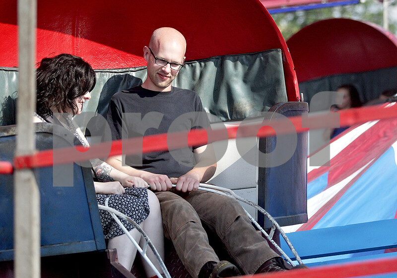 Monica Maschak - mmaschak@shawmedia.com<br /> Lexie Lannom and boyfriend Joshua Kunke, of Rockford, ride the Tilt-a-Whirl at the Kirkland Festival on Independence day. The festival runs through Sunday, July 7.