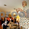 Monica Maschak - mmaschak@shawmedia.com<br /> DeKalb Library Board President Clark Nehrer stands on the hearth of his fireplace to give a toast to his guests at a party thrown by him and his wife in their DeKalb home on Saturday, June 29, 2013. The party celebrated the end of the fiscal year and the grant that is allowing them to move forward with a major expansion to the library.