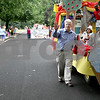 Monica Maschak - mmaschak@shawmedia.com<br /> Pastor Jim Allen, with the United Church of Christ waves to spectators as he walks along his Wizard of Oz float, which won first place, at the annual Shabbona Parade on Saturday, June 29, 2013.