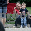 Monica Maschak - mmaschak@shawmedia.com<br /> Mason Kniffin, 2, and his mom, Katlyn Simmons, watch as floats ride by at the annual Shabbona Parade on Saturday, June 29, 2013.
