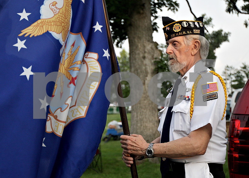 Monica Maschak - mmaschak@shawmedia.com<br /> Gene Bellinger, with the American Legion Post 66, prepares to post the colors with a U.S. Air Force flag for the Fourth of July celebration at Hopkins Park in DeKalb.