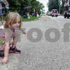 Monica Maschak - mmaschak@shawmedia.com<br /> Elizabeth Jergens, 4, picks up candy thrown from parade floats at the annual Shabbona Parade on Saturday, June 29, 2013.