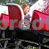 Monica Maschak - mmaschak@shawmedia.com<br /> Mackayla Downing, 4, of Rochelle, rides in the front seat of a mini coaster at the Kirkland Festival on Independence day. The festival runs through Sunday, July 7.