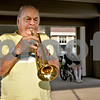 "Monica Maschak - mmaschak@shawmedia.com<br /> Sam Jones, 82, a resident at Grand Victorian in Sycamore, plays taps on his trumpet by the flag poles in front of the assisted-living home on Tuesday, July 2, 2013. Jones, a Korean Way Veteran, has been playing taps every night at 6:45 p.m. since he moved to the home two years ago. ""I play for the veterans and those that died,"" Jones said."