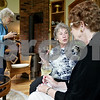 Monica Maschak - mmaschak@shawmedia.com<br /> Dorothea Bilder and Sally Stevens, with the DeKalb Library Volunteer Committee for raising money for the new expansion, chat over a glass of wine at a party thrown by DeKalb Library Board President Clark Nehrer and his wife in their DeKalb home on Saturday, June 29, 2013. The party was thrown celebrate the end of the fiscal year and the grant that is allowing them to move forward with a major expansion to the library.
