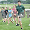 Monica Maschak - mmaschak@shawmedia.com<br /> DeKalb County Prairie Runners Coach Adam Lotito warms up with the team during practice at Huntley Middle School on Tuesday, July 2, 2013. The running club has three seasons for those who are 18 and under: cross country, indoor track and outdoor track and field.