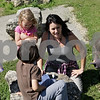 Rob Winner – rwinner@shawmedia.com<br /> <br /> Patty Ruback, of DeKalb, gathers a group of homeschooled children before a nature walk at Potawatomi Woods Forest Preserve in Kirkland, Ill., Monday, July 1, 2013.