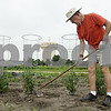 "Rob Winner – rwinner@shawmedia.com<br /> <br /> DeKalb resident Will Brown uses a hoe to turn over soil and to remove weeds from his garden at the DeKalb Garden Rental Plots located on West Dresser Road on Wednesday morning. ""I find it relaxing,"" said Brown who has rented a plot for about seven years. Brown grows cucumbers, tomatoes, peppers, onions and squash on his plot."