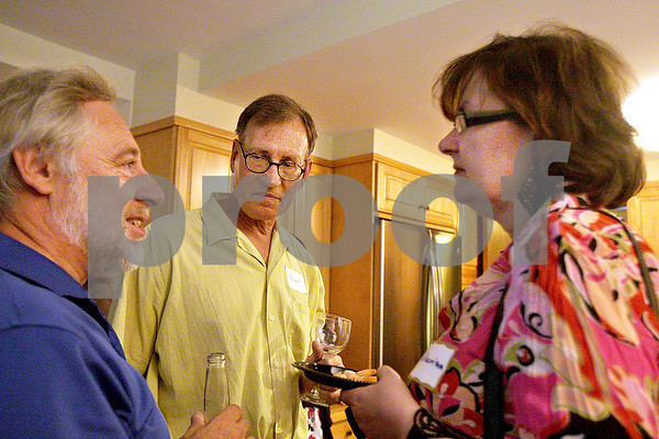 Monica Maschak - mmaschak@shawmedia.com<br /> Owner's Representative Graham Harwood, former Library Board President Wendell Johnson and his wife, Katharina Barbe socialize at a party thrown by DeKalb Library Board President Clark Nehrer and his wife in their DeKalb home on Saturday, June 29, 2013. The party celebrated the end of the fiscal year and the grant that is allowing them to move forward with a major expansion to the library.