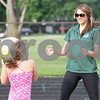 Monica Maschak - mmaschak@shawmedia.com<br /> DeKalb County Prairie Runners Coach Ashlyn Patton uses a beach ball to help long jumpers in their technique during a practice at Huntley Middle School on Tuesday, July 2, 2013. The running club has three seasons for those who are 18 and under: cross country, indoor track and outdoor track and field.