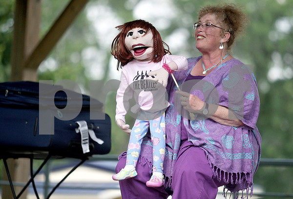 Monica Maschak - mmaschak@shawmedia.com<br /> Ventriloquiest Sandi Sylver and her New Yorker puppet, Shari Carey, teach the audience how to speak without moving their lips at the Kirkland Festival on Independence day. The festival runs through Sunday, July 7.