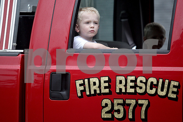 Monica Maschak - mmaschak@shawmedia.com<br /> Zachary Johnson, 3, peers out the window of a Shabbona Fire Rescure truck along the parade route at the annual Shabbona Parade on Saturday, June 29, 2013.