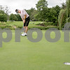 Monica Maschak - mmaschak@shawmedia.com<br /> Gary Smith putts his ball on the green of the 16th hole at Kishwaukee Country Club on Wednesday, June 26, 2013. This hole requires golfers to launch their ball over a waterway.