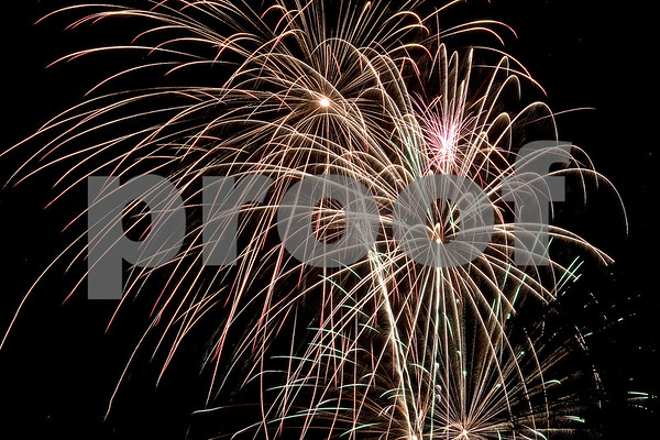Monica Maschak - mmaschak@shawmedia.com<br /> Fireworks dance across the sky for the Fourth of July celebration at Hopkins Park in DeKalb.