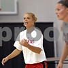 Rob Winner – rwinner@shawmedia.com<br /> <br /> Northern Illinois University women's basketball assistant coach Debbie Whitman gives instructions as Jenna Thorp (right) prepares to take part in a drill during practice at Victor E. Court inside the Convocation Center on the NIU campus in DeKalb, Ill., Thursday, June 27, 2013. Whitman is a former DeKalb High School girls basketball coach.