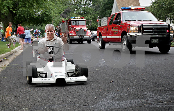 Monica Maschak - mmaschak@shawmedia.com<br /> Steve Klopfenstein, with Country Financial, rides in a go cart along the parade route at the annual Shabbona Parade on Saturday, June 29, 2013.