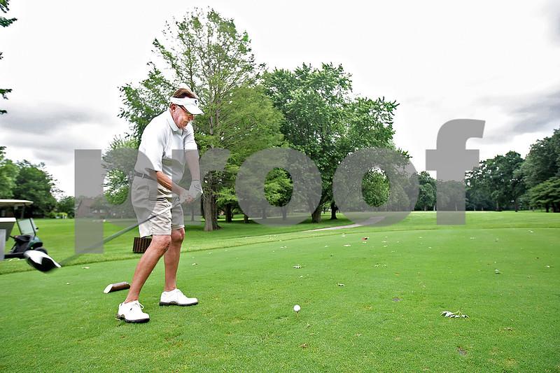 Monica Maschak - mmaschak@shawmedia.com<br /> Mickey Johnson of DeKalb tees off at the 14th hole at Kishwaukee Country Club on Wednesday, June 26, 2013.