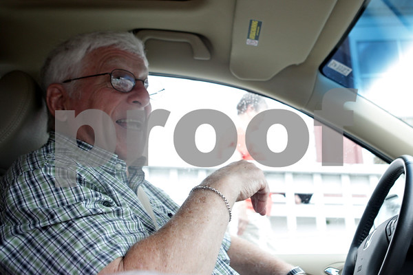 Rob Winner – rwinner@shawmedia.com<br /> <br /> Don Anderson (front) waits inside of his van as his wife, Dee, finishes up a delivery to a Meals on Wheels client in DeKalb, Ill., Tuesday, July 9, 2013.