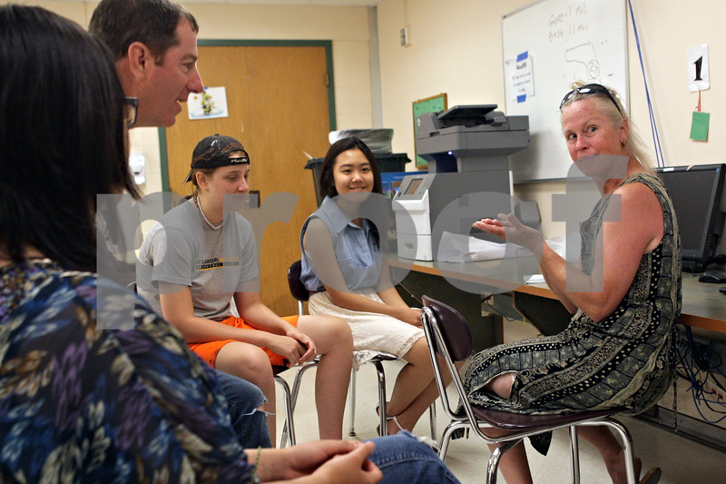 Rob Winner – rwinner@shawmedia.com<br /> <br /> Sycamore High School biology teacher Scott Horlock (left) and his students listen as Donna Prain (right) of Northern Illinois University speaks about the areas watershed on Wednesday, July 10, 2013. Horlock's students will be volunteering their time this summer to collect data concerning the Kishwaukee watershed.