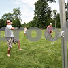 Monica Maschak - mmaschak@shawmedia.com<br /> Donny Gardner misses the volleyball on a play during a get-together with friends at Hopkins Park on Saturday, July 6, 2013.