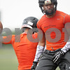 Rob Winner – rwinner@shawmedia.com<br /> <br /> DeKalb receiver Rudy Lopez (left) cerebrates with running back Dre Brown after a touchdown catch during a 7-on-7 scrimmage against Rockford Lutheran in DeKalb, Ill., Monday, July 8, 2013.