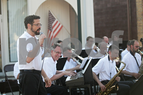 """Monica Maschak - mmaschak@shawmedia.com<br /> Gavin Wilson, a trumpet player for Jazz in Progress, sings, """"Alright, Okay, You Win"""" with the band during a Tuesdays on the Town: Salute to America event in Sycamore on July 9, 2013. Tuesdays on the Town are presented by the city of Sycamore and Discover Sycamore."""