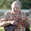 Monica Maschak - mmaschak@shawmedia.com<br /> Steven Keefe, also known as Ukulele Grandpa, performs for families at the Sycamore History Museum on Wednesday, July 10, 2013. Keefe told stories and sang family-friendly songs.