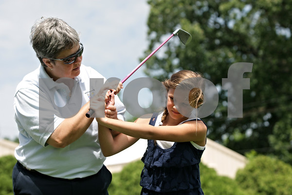 Rob Winner – rwinner@shawmedia.com<br /> <br /> LPGA and PGA golf professional Pam Tyska instructs Gwyn Golembiewski, 11, while working on pitching at the Buena Vista Golf Course in DeKalb, Ill., Tuesday, July 2, 2013.