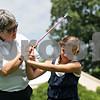 Rob Winner – rwinner@shawmedia.com<br /> <br /> LPGA and PGA golf professional Pam Tyska instructs Gwyn Golembiewski, 11, while working on pitching at the Buena Vista Golf Course in DeKalb, Ill., Tuesday, July 2, 2013.