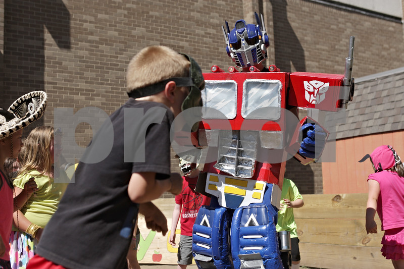 """Rob Winner – rwinner@shawmedia.com<br /> <br /> Rob Winner – rwinner@shawmedia.comDressed as Optimus Prime, John Quade of the Kishwaukee Family YMCA in Sycamore dances to """"Harlem Shake"""" with a group of day campers on Friday afternoon while being filmed. Throughout the day kids dressed up in costumes and were filmed for the video which will be posted to the Kishwaukee Family YMCA Summer Day Camp Facebook page."""