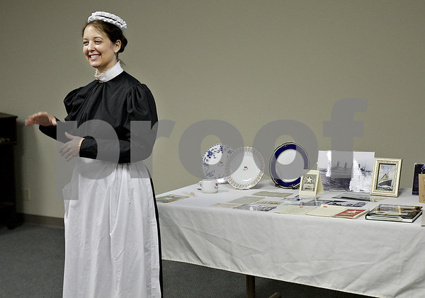 Monica Maschak - mmaschak@shawmedia.com<br /> Leslie Goddard reenacts the life of Violet Jessop, a stewardess who survived both the sinking of the Titanic and the sinking of her identical sister ship, the Britannic, at the Resource Bank in Genoa on Thursday, July 11, 2013.