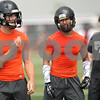 Rob Winner – rwinner@shawmedia.com<br /> <br /> DeKalb running back Dre Brown (center) gets into position before a play during a 7-on-7 scrimmage against Rockford Lutheran in DeKalb, Ill., Monday, July 8, 2013.