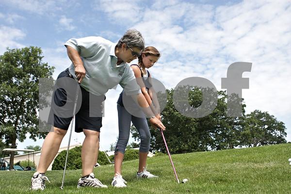 Rob Winner – rwinner@shawmedia.com<br /> <br /> LPGA and PGA golf professional Pam Tyska instructs Gwyn Golembiewski, 11, at the Buena Vista Golf Course in DeKalb, Ill., Tuesday, July 2, 2013.
