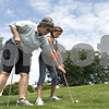 Rob Winner – rwinner@shawmedia.com<br /> <br /> LPGA and PGA golf professional Pam Tyska instructs Gwyn Golembiewski, 11, at the Buena Vista Golf Course in DeKalb, Ill., Tuesday, July 2, 2013.