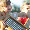 Monica Maschak - mmaschak@shawmedia.com<br /> Kaylyn Wackerlin, 4, of Waterman, plays the washboard with the Ukulele Grandpa during an interactive song at the Sycamore History Museum on Wednesday, July 10, 2013.