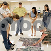 Rob Winner – rwinner@shawmedia.com<br /> <br /> Sycamore High School biology teacher Scott Horlock (center) and his students listen as Donna Prain (right) of Northern Illinois University uses a map to point out retention and detention ponds in the DeKalb and Kane counties on Wednesday morning. Horlock's students will be volunteering their time this summer to collect data concerning the Kishwaukee watershed.