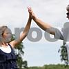 Rob Winner – rwinner@shawmedia.com<br /> <br /> Gwyn Golembiewski (left), 11, high-fives Pam Tyska at the Buena Vista Golf Course in DeKalb, Ill., Tuesday, July 2, 2013.
