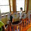 Monica Maschak - mmaschak@shawmedia.com<br /> Tourists walk down the spiralling staircase during a staff and servants tour of the Ellwood House in DeKalb on Wednesday, July 10, 2013. Participants watched a short film on the staff and servants of the house, then picked a member to role play during the tour of the house.
